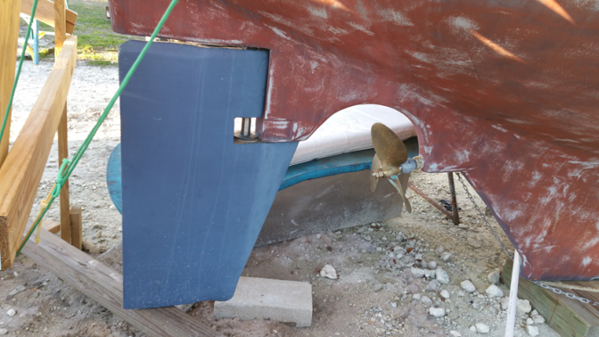 Our rudder weighs over 175lbs. Jeff sealed the cracks with apoxy and fiberglass.